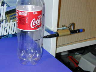 Make cutmarks on a coke bottle